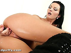 Well-lubed black-haired charmer Niky Peach plumb glass faux-cock from behind