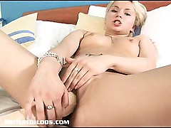 Ash-blonde Russian fills her cock-squeezing puss with a ample brutal faux-cock