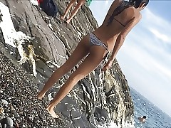 Teenager ass in wet bikini at the beach