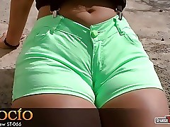 Big round bottomed teen in green shorts (cameltoe)