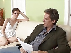 Young slim black-haired babe on sofa sucking and pulverizing stepdad's dick