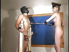 Skinny beautiful blond mistress whips and torments victim