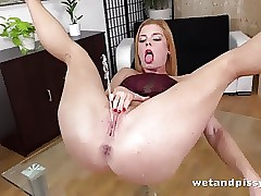 Stunner licks her pee off table before frenzied pussy play