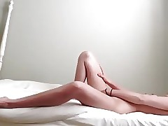 Teen masterbates and cums on her bed