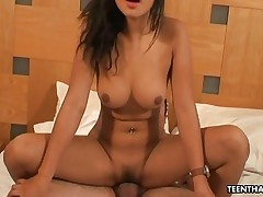 Cock-squeezing Thai babe getting her pussy doggystyle hammered