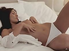 Solo cutie pushes fingers in vag