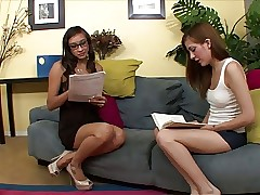 Asian beauty sits on sapphic brunette's face with her snatch