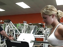 Hot gym girl deep-throats the trainer's pole after a workout