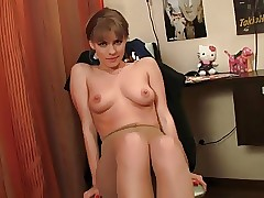 Cute russian dame Zina strips and poses on stocking