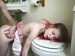 Mischievous redhead fucked in the bathroom