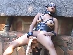 Black BDSM Sex Gimp Playing with Fake penis