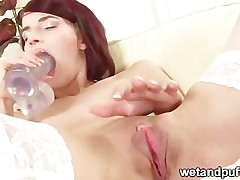 redhead pleasing her pussy
