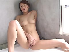 Ultra-cute Asian frigs her fur covered snatch in the tub